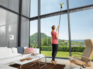 Cleaning hard-to-reach windows with a window vac plus extension pole