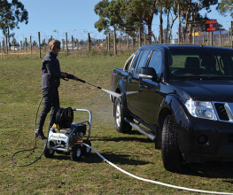 Air compressor with a small footprint that fits into utes and trailers