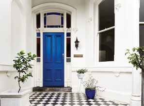 Creating impact by painting a door in a bold colour with a water-based enamel paint from Dulux