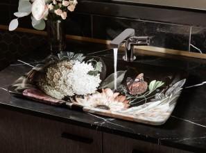 Bathroom basins featuring bold, lush florals on a deeply dark background